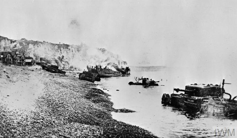 Burnt out tanks and landing craft lie strewn across the beach at Dieppe after the Allied withdrawal. © IWM. (HU 1905)